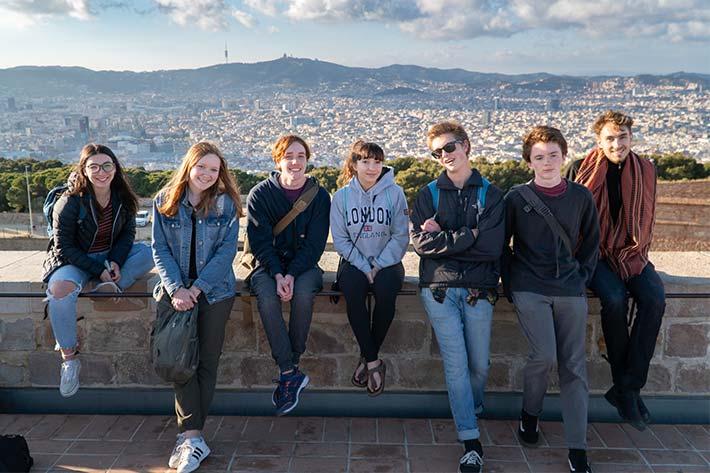 Students over the Barcelona skyline