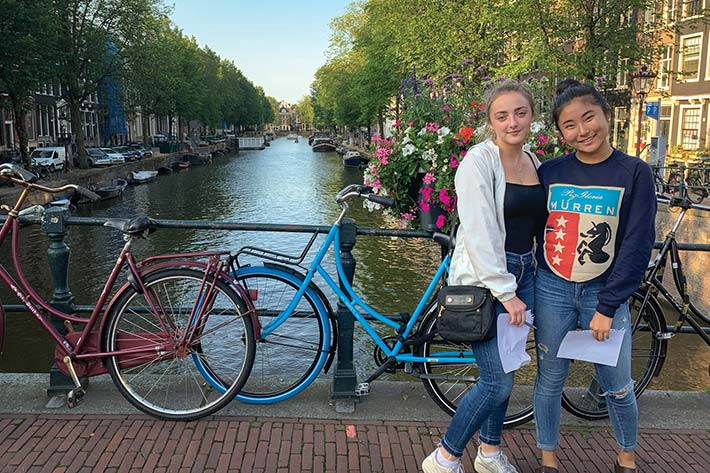 Students in front of Amsterdam Canals