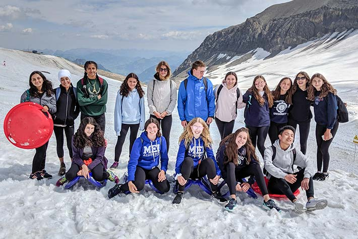 Students in the snow covered Alps
