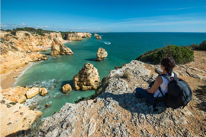 Student on the cliffs of the Algarve