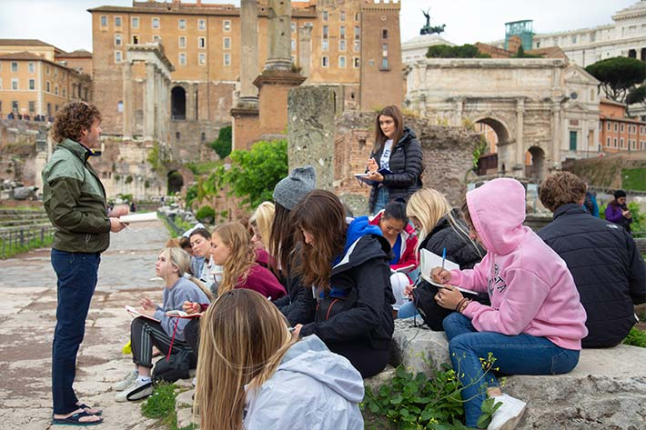 Students gathered in Roman ruins