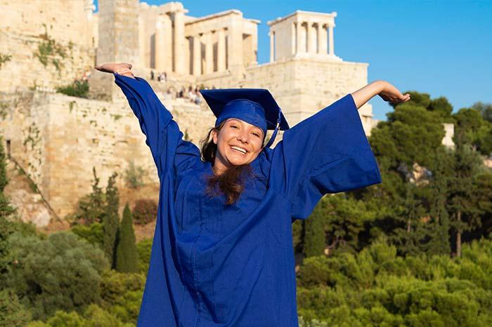 Graduate in front of Greek Ruins